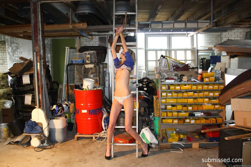 StrugglingBabes.com – Irena tied to ladder ballgagged.. Irena  Male Dominant